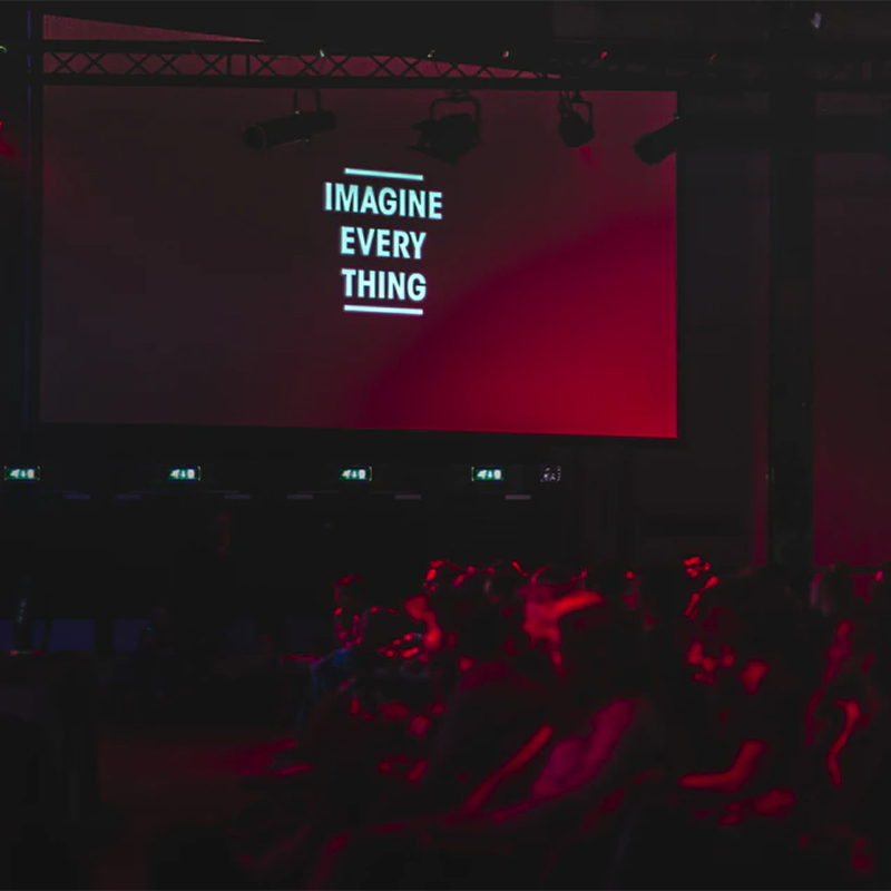 Event hall with a large banner that reads imagine everything